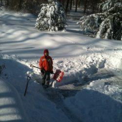 boy earning money old school: shoveling snow