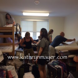 Parents helping college kid set up dorm room
